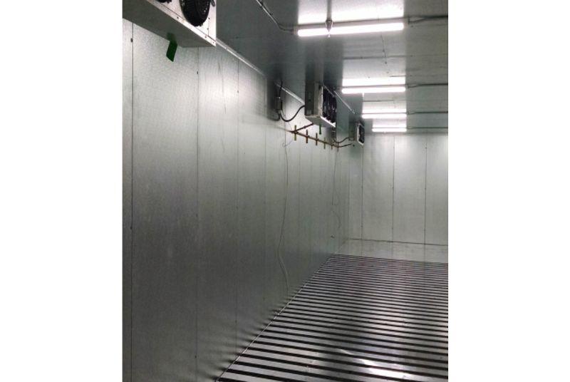 interior of walk-in cooler with evaporators