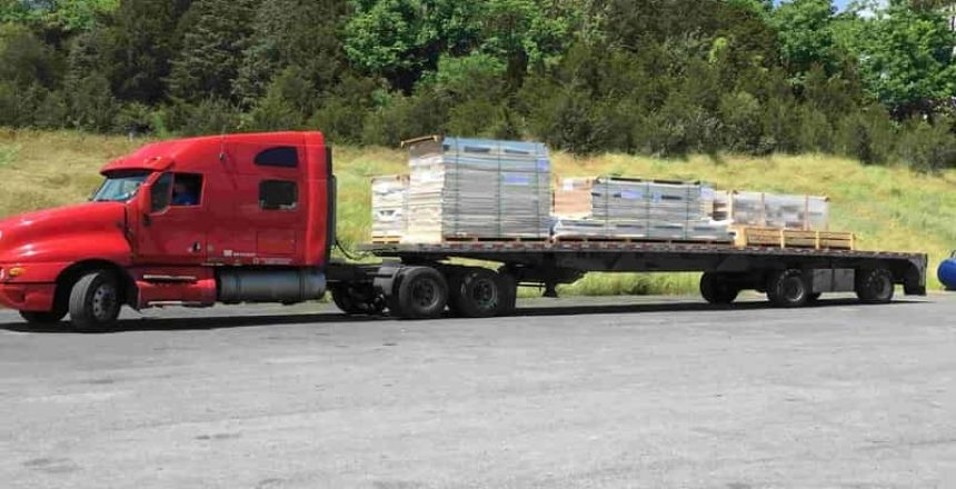 truck carrying walk-in coolers and freezers